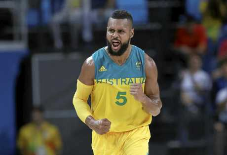 Australia's Patty Mills celebrates after scoring during the men's bronze medal basketball game against Spain at the 2016 Summer Olympics in Rio de Janeiro, Brazil.