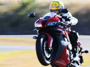 Qld racer still critical after bike smashing into wall