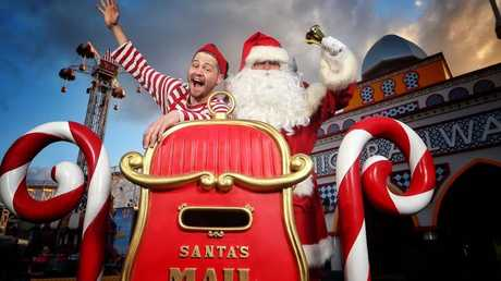 Christmas in July celebrations are cranking up, such as here at Melbourne's Luna Park. But the weather isn't playing ball. Picture: Hamish BlairSource:News Corp Australia