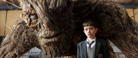 Lewis MacDougall and The Monster (voiced by Liam Neeson) in a scene from the movie A Monster Calls.
