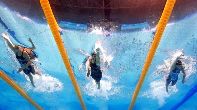 (L-R) Emma Mckeon of Australia, Katie Ledecky of the United States and Leah Smith of the United States compete during their Women's 200m Freestyle semi final. Photo:Getty Images