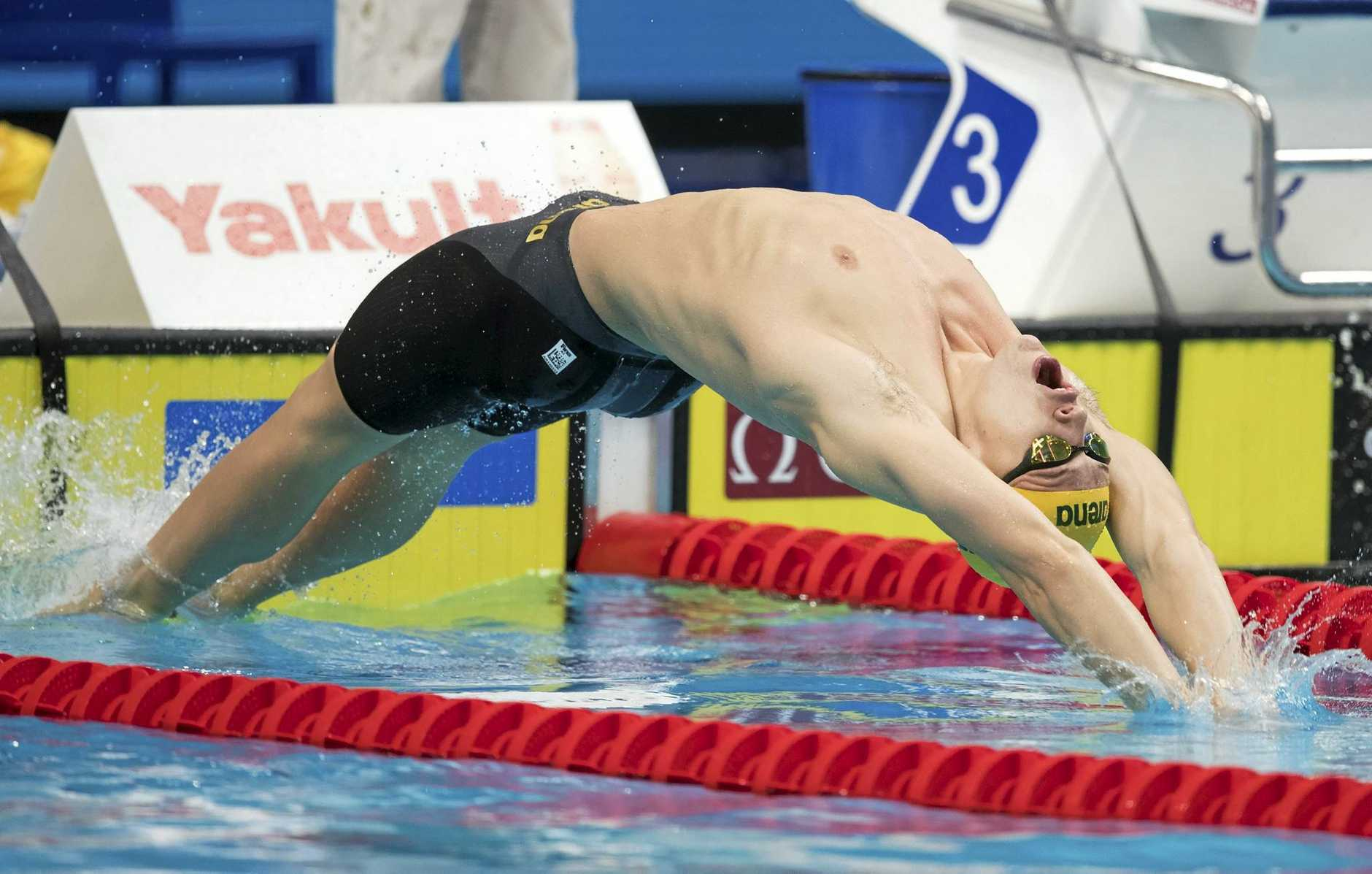 Mitch Larkin of Australia competes in the men's 100m backstroke heats