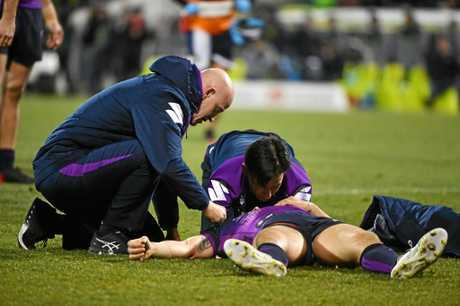 Billy Slater is tended to by medical staff after being knocked out during the Round 20 clash against the Raiders.