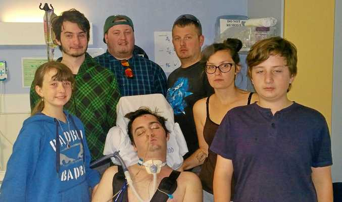 Bo Oliffe surrounded by his siblings in hospital in Brisbane.