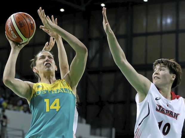 Australian centre Marianna Tolo (14) drives to the basket against Japan.