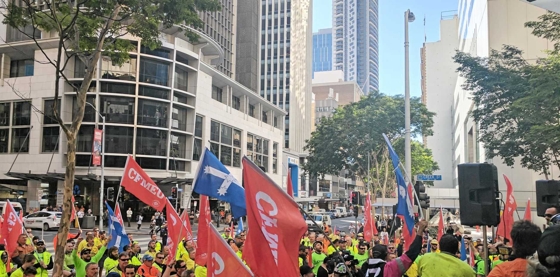 Unionists rally outside Glencore's Brisbane headquarters calling for a resolution of ongoing Oaky North negotiations.