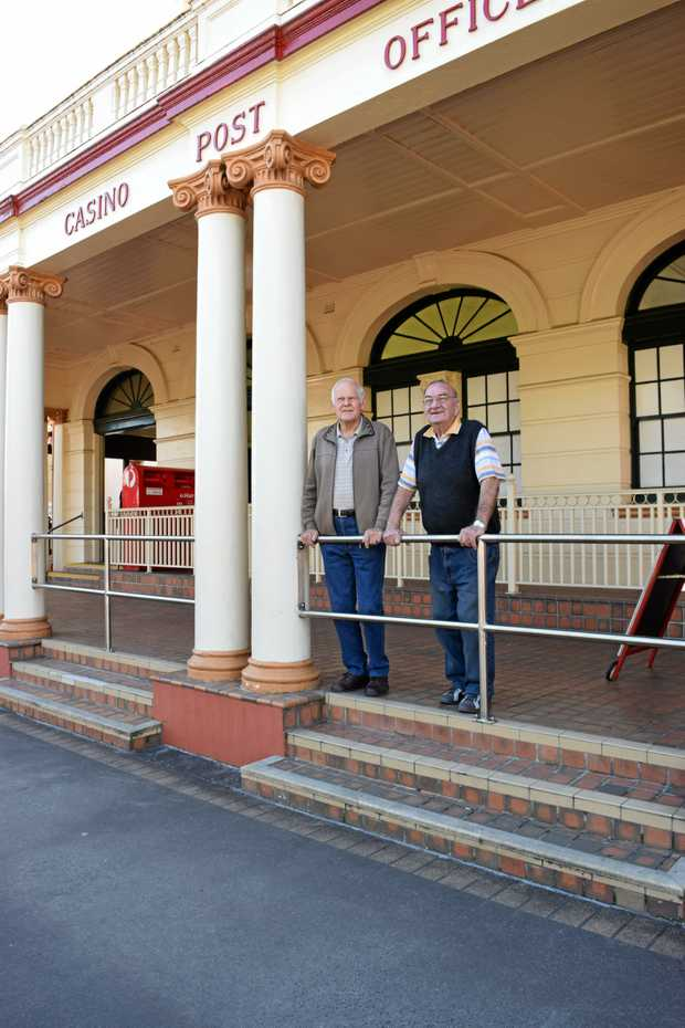 PROUD OF THE TOWN: Casino Folk Museum's Barry Dennis and Bob Moran at the 1879 post office building.