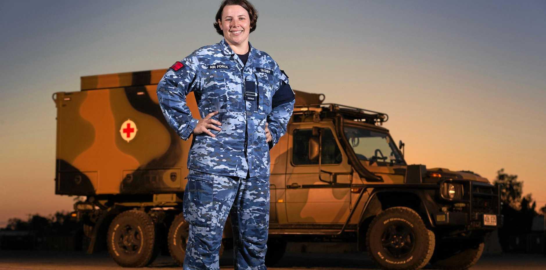 ROCKY DEPOLYMENT: RAAF Nursing Officer, Flight Lieutenant Amanda Gloury with a Mercedes G-Wagon ambulance outside the Role 2 Health Facility at Rockhampton during Exercise Talisman Saber 2017.