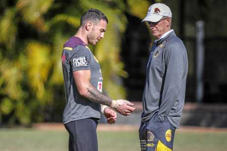 Darius Boyd (left) discusses his injured thumb with Broncos coach Wayne Bennett at training.