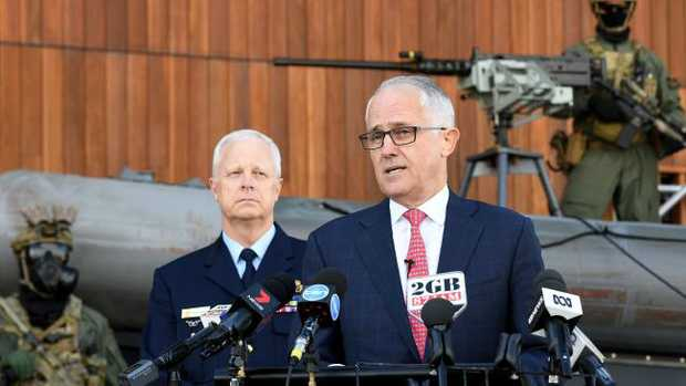 "Australian Prime Minister Malcolm Turnbull recently announced the sweeping new Home Affairs Department, along with new ""call out"" powers for the military. He's pictured at Holsworthy Barracks with members of 2 Commando."