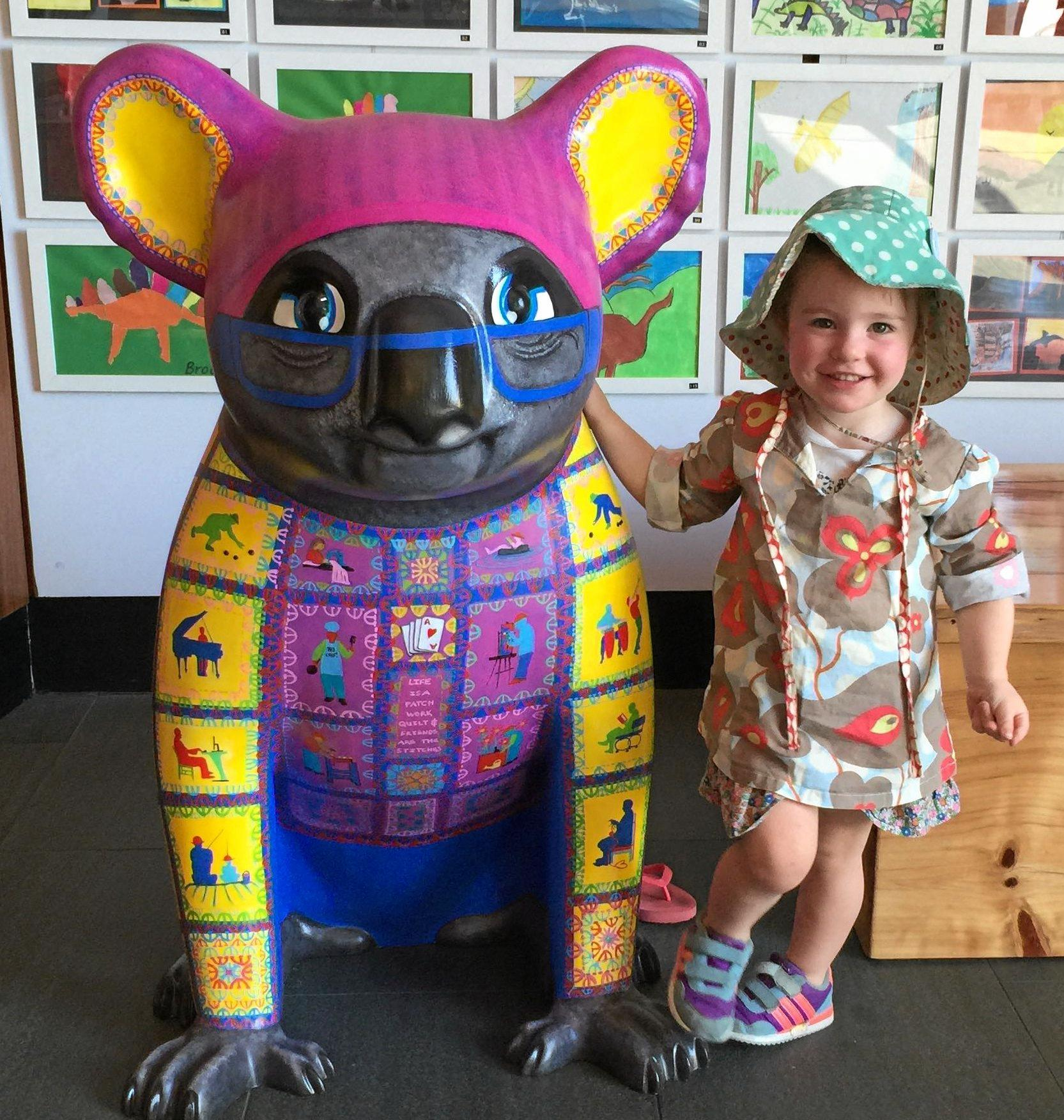 OMA, the mascot for the Creative Ageing Festivals, has won a heart in Margret Meagher's granddaughter, Fife.