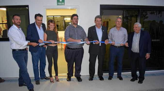 SURF CLUB: Politicians gather with Eimeo Surf Live Saving Club president Bill Lansbury for the cutting of the ribbon.
