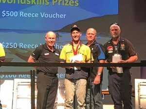 PROUD MOMENT: Dylan Nightingale receiving the plumbing award in Caloundra.