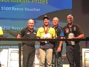 PROUD MOMENT: Dylan Nightingale receiving the plumbing award in Caloundra.