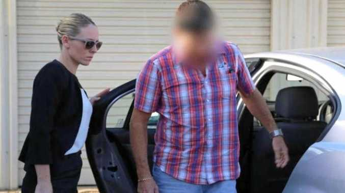 Allan Kenneth Brookes is arrested by police outside his Coffs Harbour business in 2014.