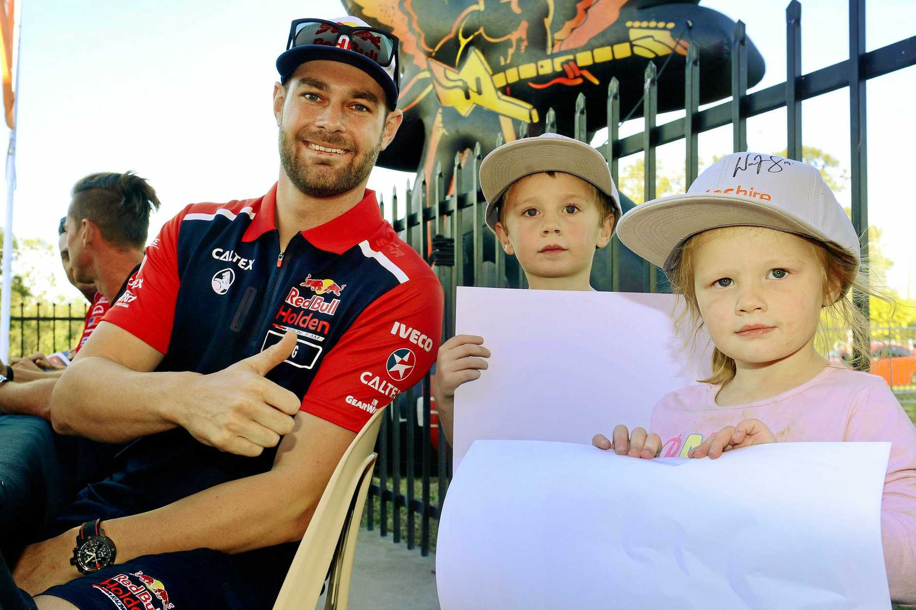 Defending Supercars champion Shane Van Gisbergen with Cameron Payne, 4, and Kalie Payne, 3, of One Mile.