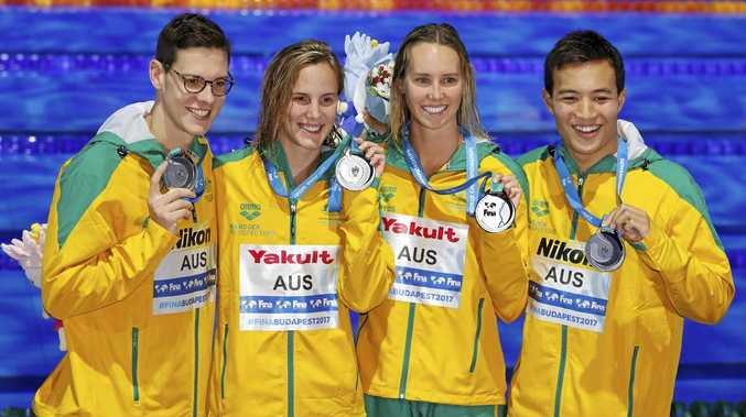 MEDAL WINNERS: Australian swimmers (from left) Mitchell Larkin, Bronte Campbell, Emma McKeon and Daniel Cave were all smiles after winning silver in the mixed medley relay final at world swimming championships in Budapest, Hungary.