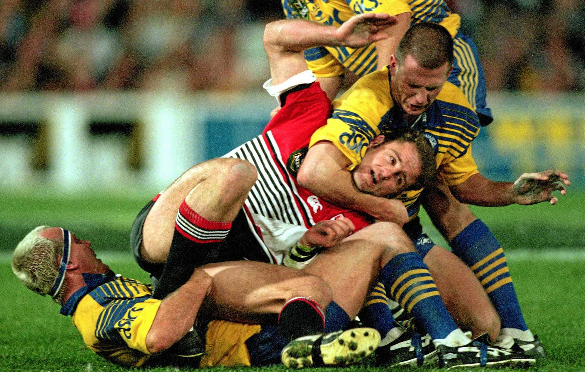 NAME CHANGE: North Sydney Bears forward Billy Moore is tackled by Parramatta Eels players Jason Smith during a NRL Final Series in 1998. Moore wants to see the Bears move to the Gold Coast and takeover the Titans.