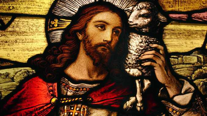 IN CROSSHAIRS: Stained glass depicting Jesus holding a lamb. Jesus could be on borrowed time in Queensland public schools.