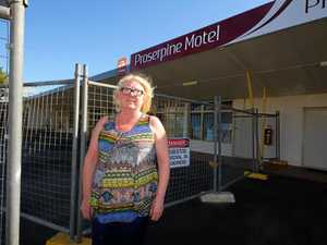 Manager of the Proserpine Motel, Sylvia Grewer, in front of the cyclone ravaged building.