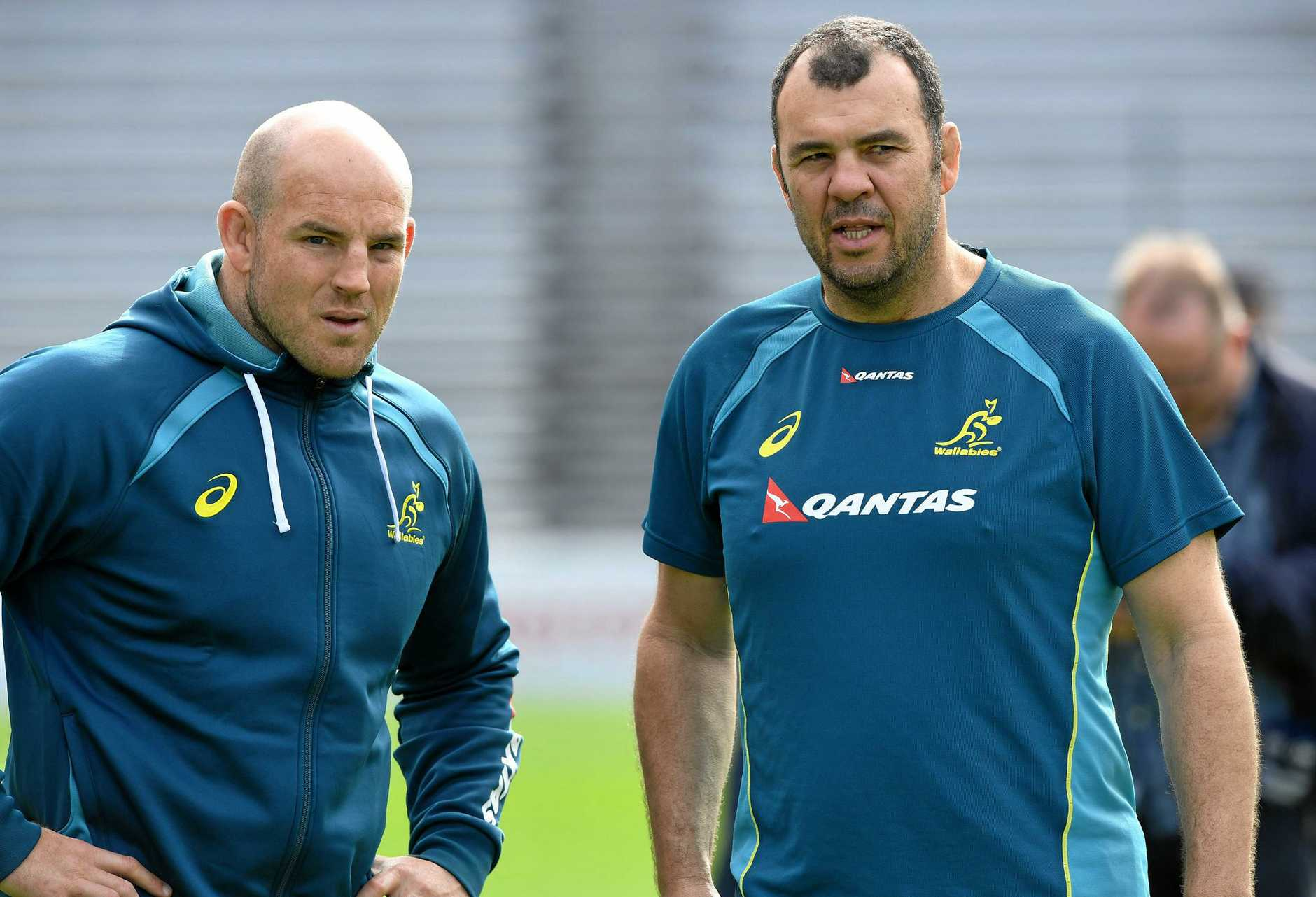 Stephen Moore (left) and coach Michael Cheika during the Australian Wallabies team training session at Ballymore in Brisbane, Tuesday, June 20, 2017. The Wallabies are in preparation for their Test match against Italy on Saturday at Suncorp Stadium. (AAP Image/Dave Hunt) NO ARCHIVING