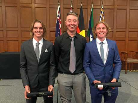 INSET: The brothers with their cousin Brock Walker (middle) at the ceremony last week.