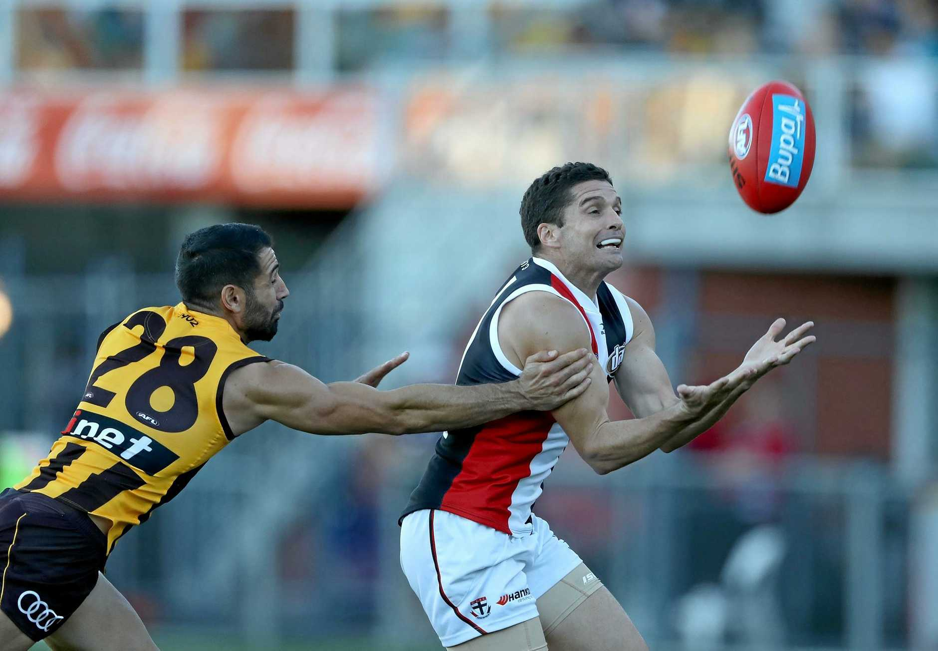 INJURY CONCERNS: Saints veteran Leigh Montagna takes a mark in front of the Hawks Paul Puopolo. Montagna is weighing up his future in the game after suffering a severe hamstring injury which may force him into retirement.