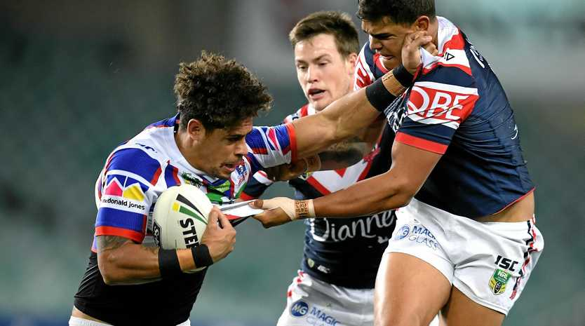 ROLLERCOASTER CAREER: Knights winger Dane Gagai is tackled by Latrell Mitchell of the Roosters. Gagai's career is one of highs and lows - Gagai was homeless after being sacked by the Broncos to winning the Wally Lewis medal during this year's State of Origin medal.