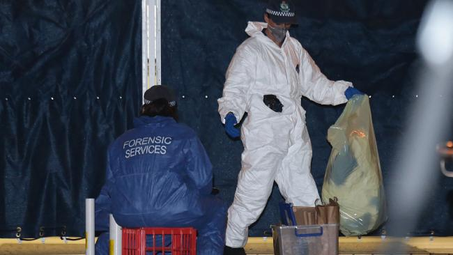 Forensic crews worked through the night following the fatal shooting. Picture: Bill Hearne