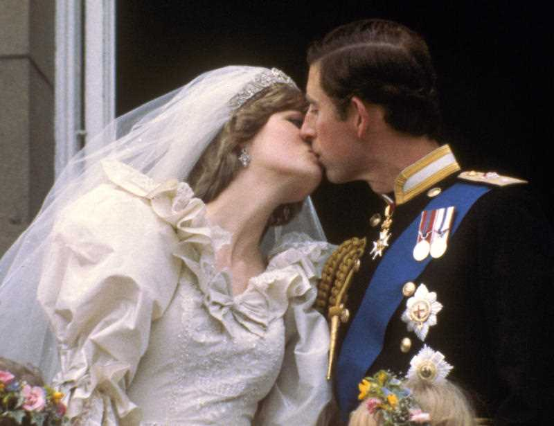 Britain's Prince Charles kisses his bride, Princess Diana, on the balcony of Buckingham Palace in London, after their wedding.