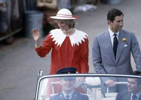 Princess Diana waves to the crowd as she and Prince Charles visit Renmark in southern Australia's Riverland area, April 6, 1983.