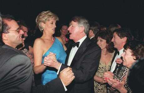 Princess Diana reacts to comments by her dancing partner, ex Premier of New South Wales, Neville Wran as the crowd cheers her on at The Victor Chang Cardiac Research Institute Dinner Dance in Sydney Australia, Thursday, October 31, 1996.