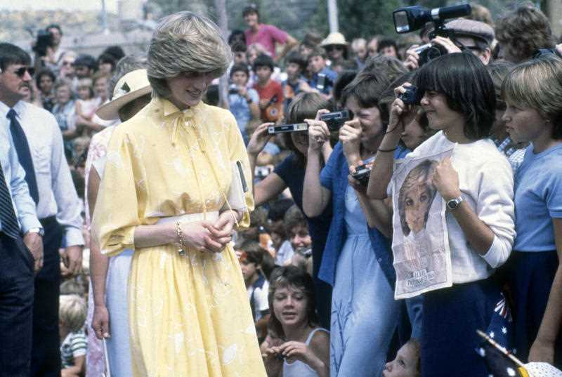 Diana, Princess of Wales is photographed by youngsters during her visit to Alice Springs, Australia, March 21, 1983.