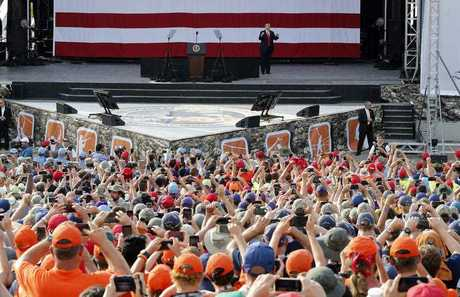 President Donald Trump waves to the crowd of scouts at the 2017 National Boy Scout Jamboree at the Summit in Glen Jean,W. Va., Monday, July 24, 2017.