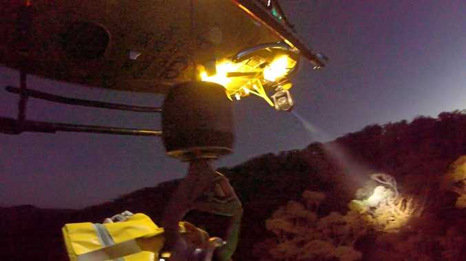 LEFT: The RACQ Capricorn Helicopter Rescue Service searches for an injured man at Kroombit Tops National Park at the weekend.