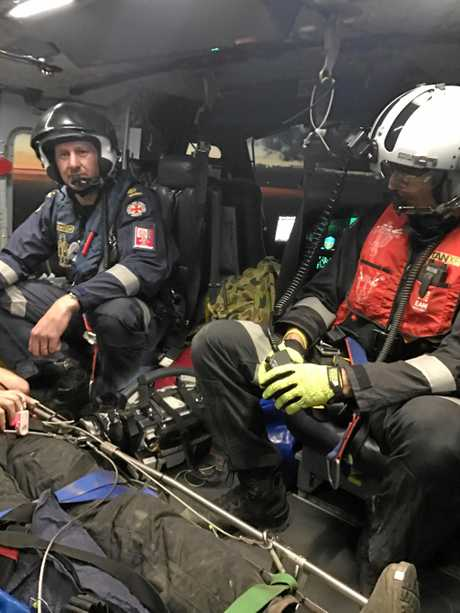 Rescue service crewmen on board the Kroombit Tops mission.