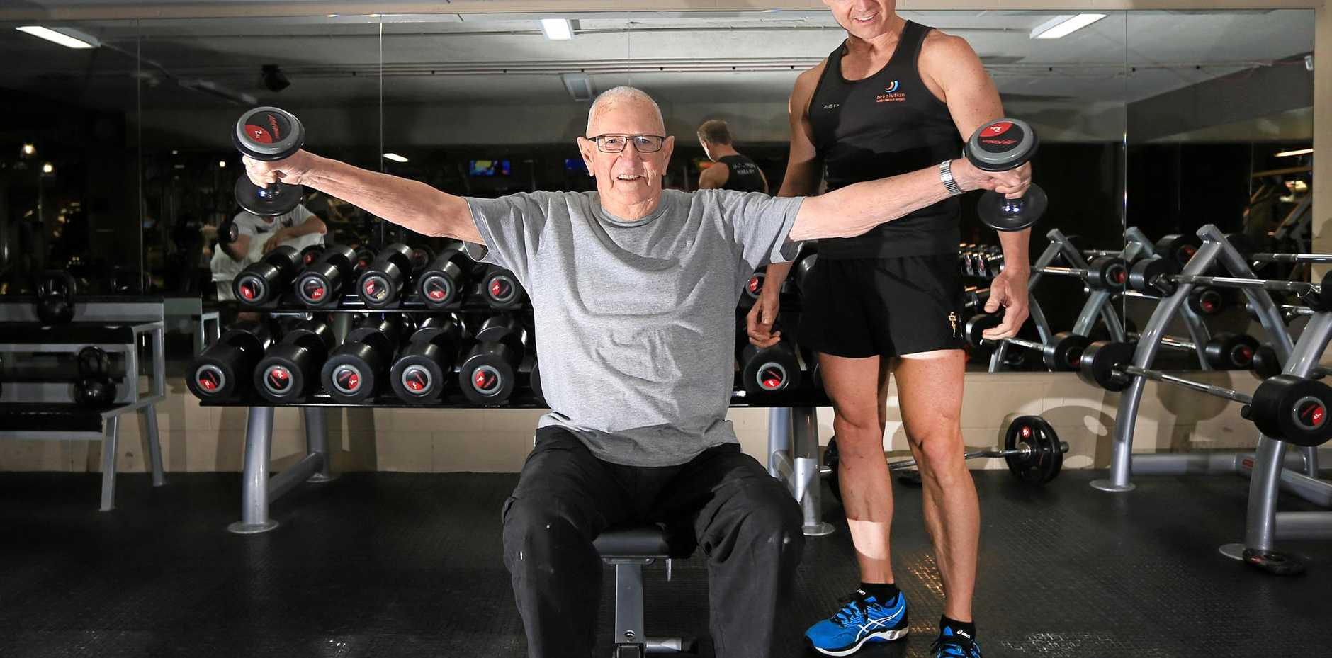 REACHING HIS GOALS: Personal trainer Rusty Roberts puts 90-year-old Rod Stebbins through a workout.