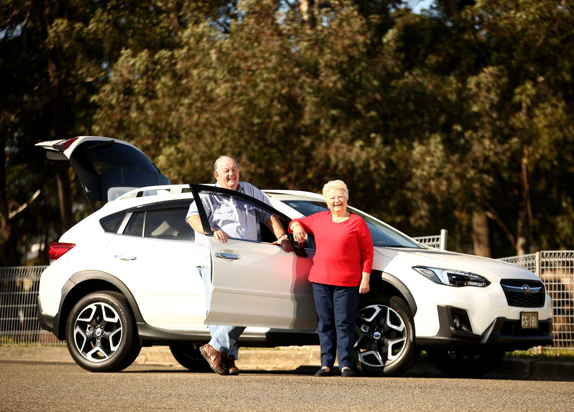 Greg and Margaret Scott pose for photographs with their Subaru XV near their home in Greystanes.