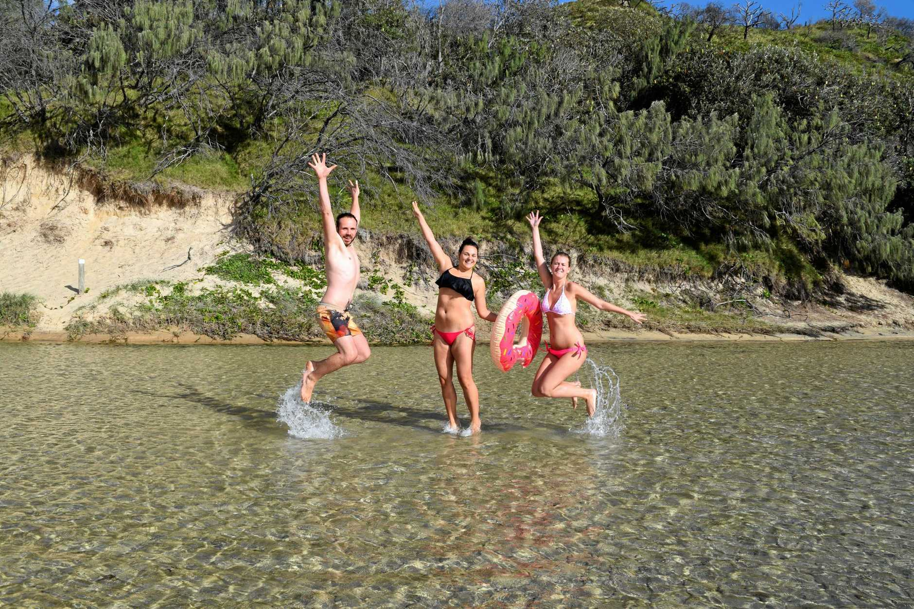 Sven Knoff, Steffi Zettelmayer and Nadine Strzempek say out of everywhere they have been, they love Fraser Island the most. Here they're pictured at Eli Creek.