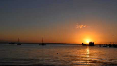 The barge leaves Kingfisher Bay as sun sets on Fraser Island.