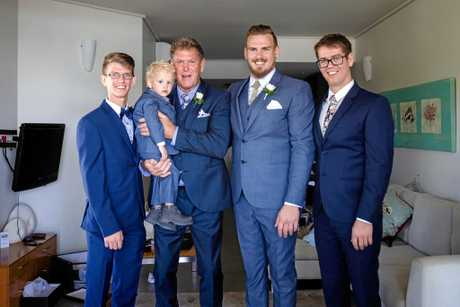 Aaron with the groomsmen before his special day.
