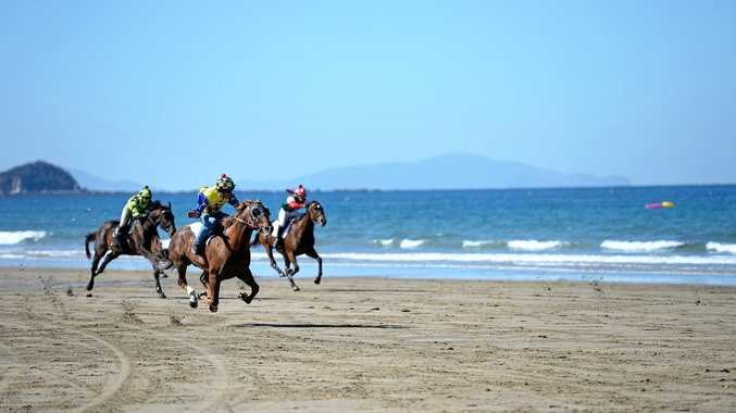Carla Adams on Titanium Rock, Charlie Prow on Kelly Star and Madeline Lee on Rockin Partypowere down the beach at the Mackay Beach Races