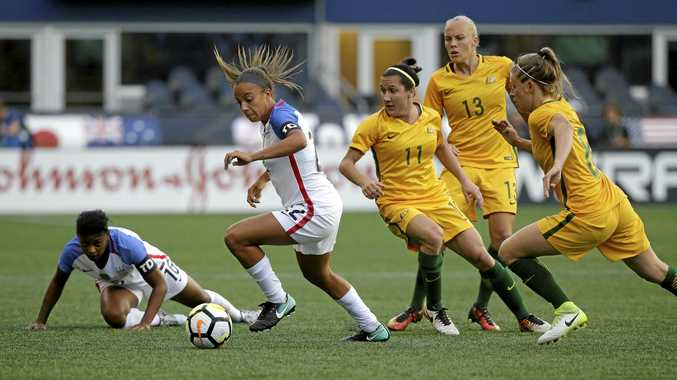 US forward Mallory Pugh (second from left) moves the ball away from Australia's Lisa De Vanna, Tameka Butt and Elise Kellond-Knight.