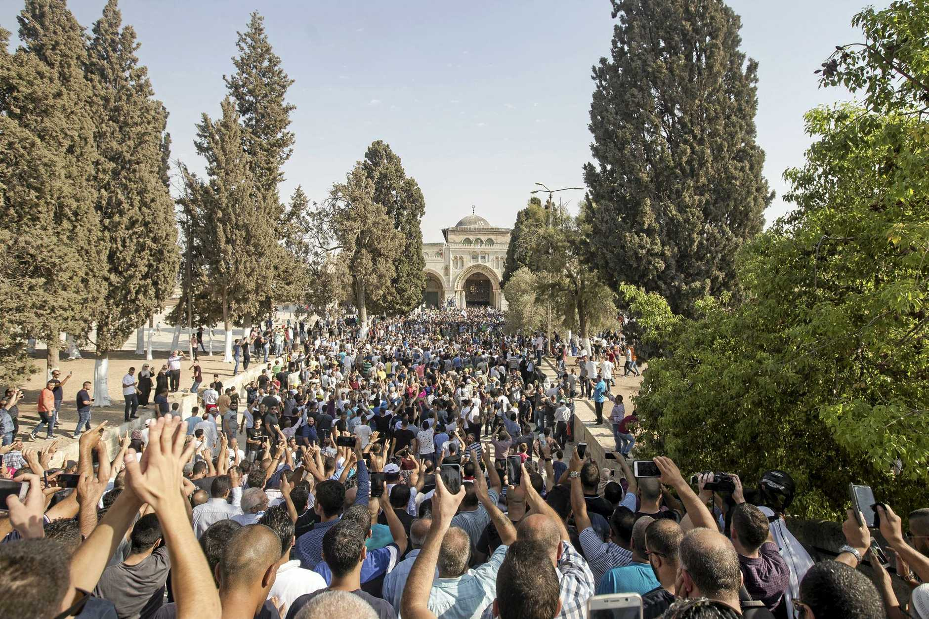 Palestinian worshippers enter the Al-Aqsa Mosque compound in the Old City of Jerusalem.