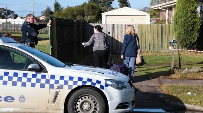 Police talk to people at the house where an LPG explosion occurred in Howitt Ave Corio. Picture: Alison Wynd