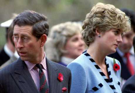 Princess Diana and Prince Charles look in different directions during a Korean War commemorative service in November, 1992.
