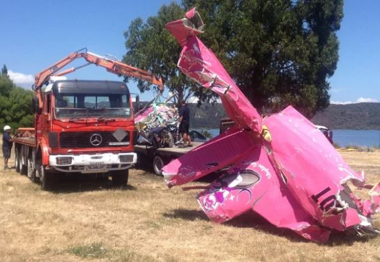 Part of the skydiving plane is dragged from Lake Taupo.