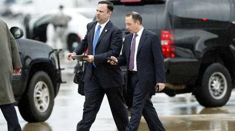 White House Director of Social Media Dan Scavino, left, walks to a vehicle with former White House Chief of Staff Reince Priebus as they arrive Friday, July 28, 2017, at Andrews Air Force Base, Md. Trump says Homeland Secretary Secretary John Kelly is his new White House chief of staff.