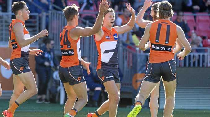 Lachie Whitfield of the Giants celebrates a goal against the Dockers.