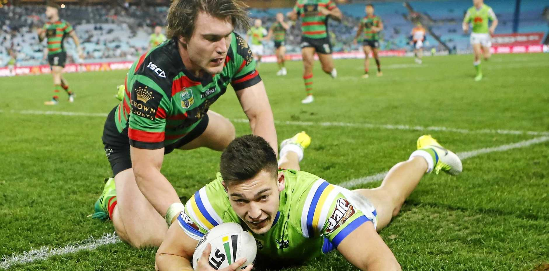 Nick Cotric of the Raiders scores a try against the Rabbitohs.